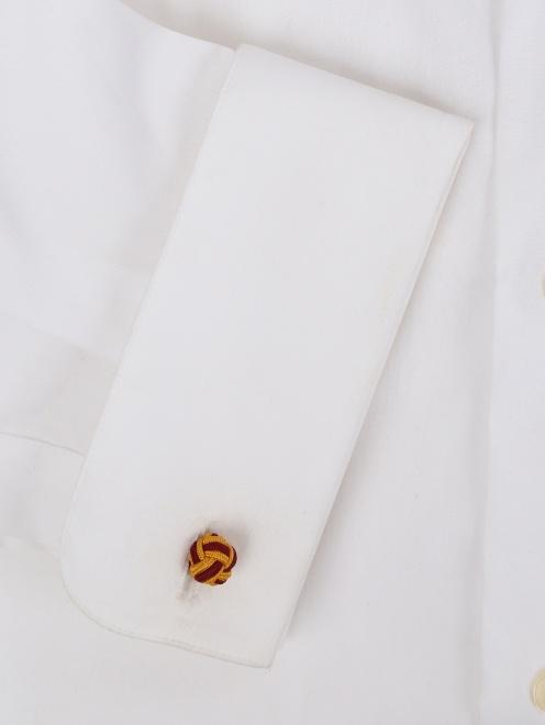 Запонки из текстиля в виде узелков - Деталь