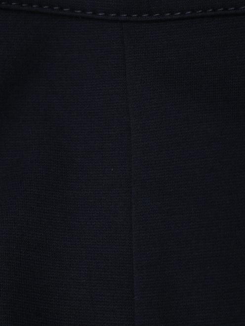 Широкие трикотажные брюки с металлическим декором - Деталь1